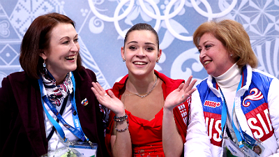 Аделина Сотникова со своими тренерами
